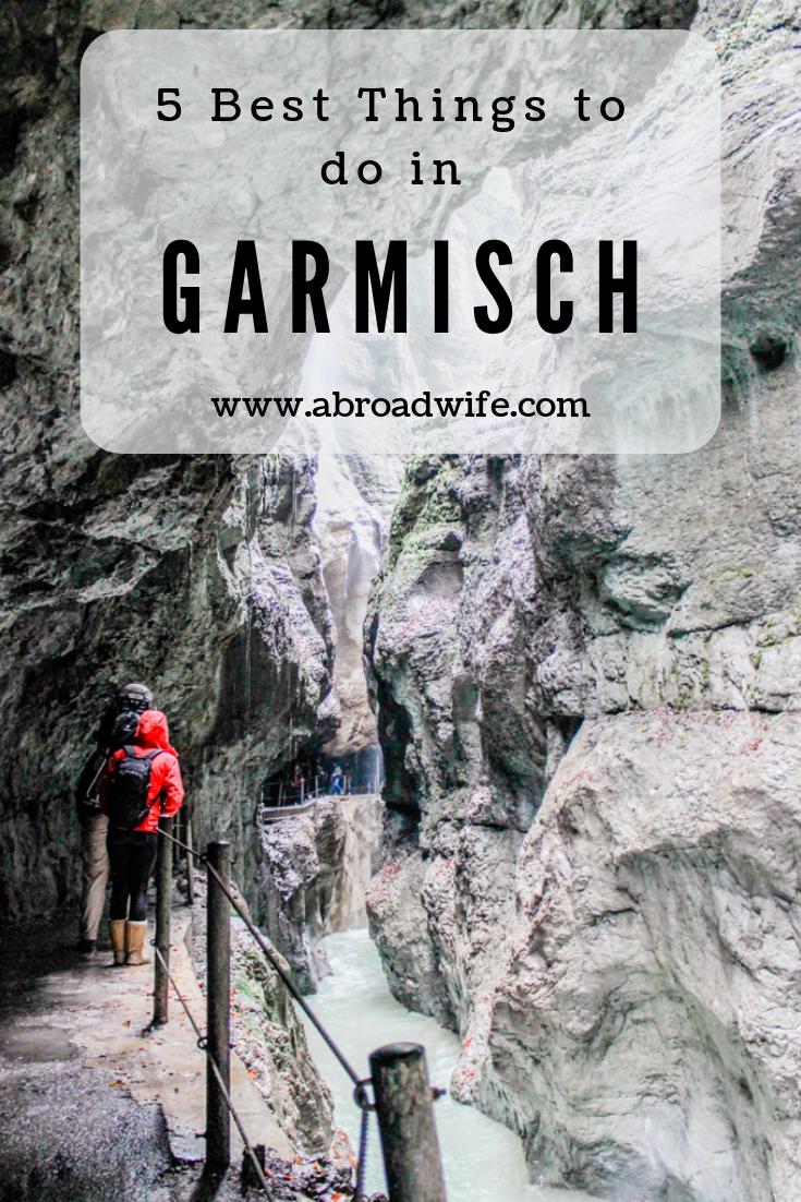 """Couple hiking through rocky Partnach Gorge in Garmisch, Germany. Text overlay """"5 Best Things to do in Garmisch"""""""