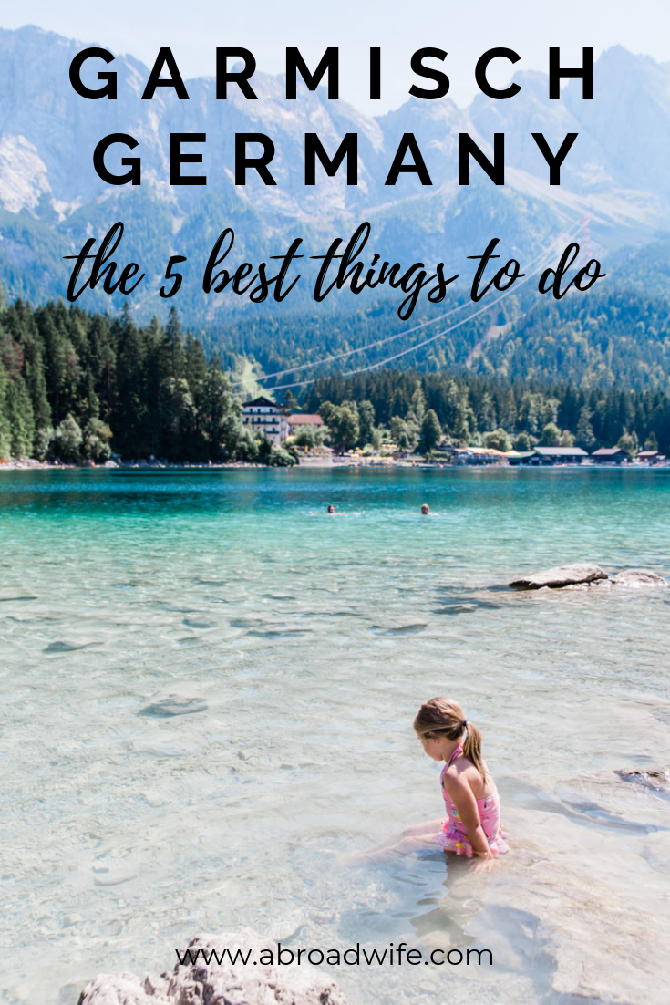 """Little girl swimming in bright blue water at Eibsee. Text overlay """"Garmisch, Germany the 5 best things to do"""""""