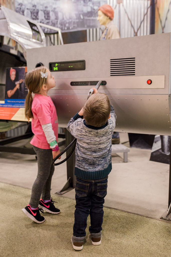 Kids trying out riveting on a display at the Museum of American History in Washington D.C.