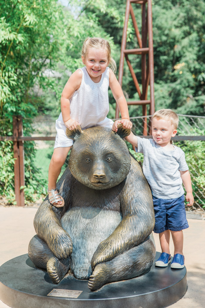 Kids posing with the panda statue at the National Zoo in Washington D.C.