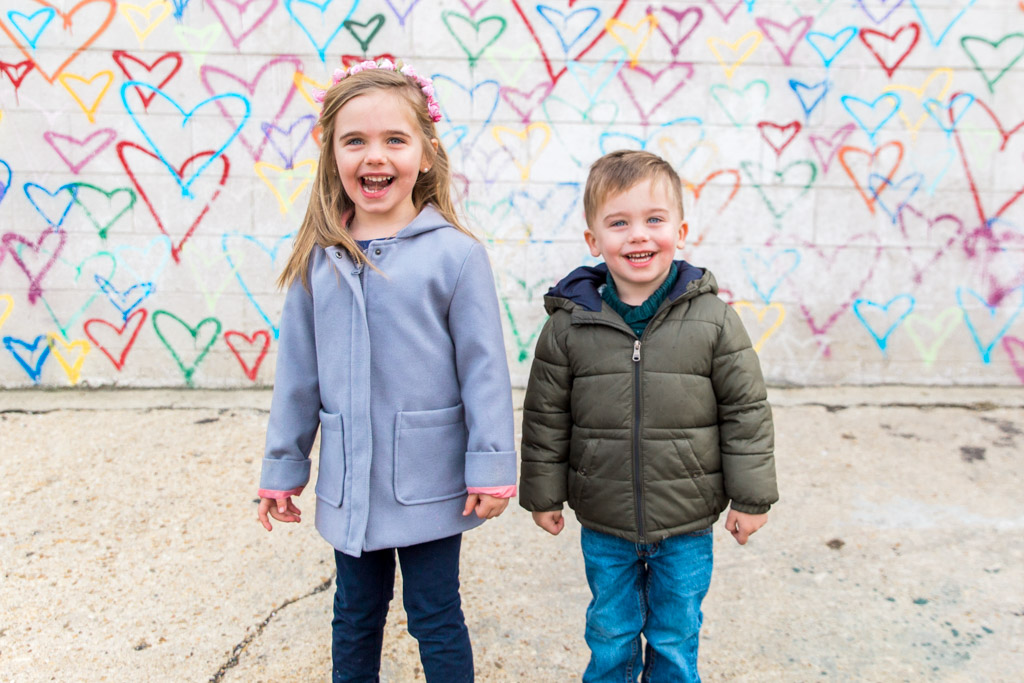 Kids in front of the colorful heart graffiti wall at Union Market in Washington D.C.