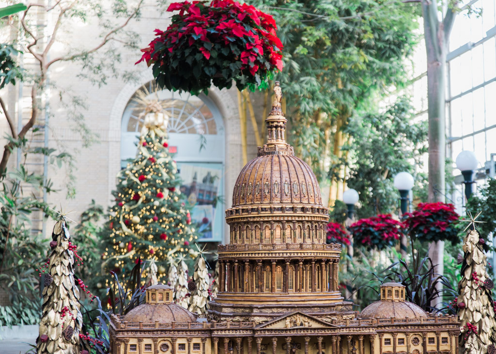 Model of the U.S. Capitol made out of plant materials with the Christmas tree and Christmas decorations at the U.S. Botanic Garden.