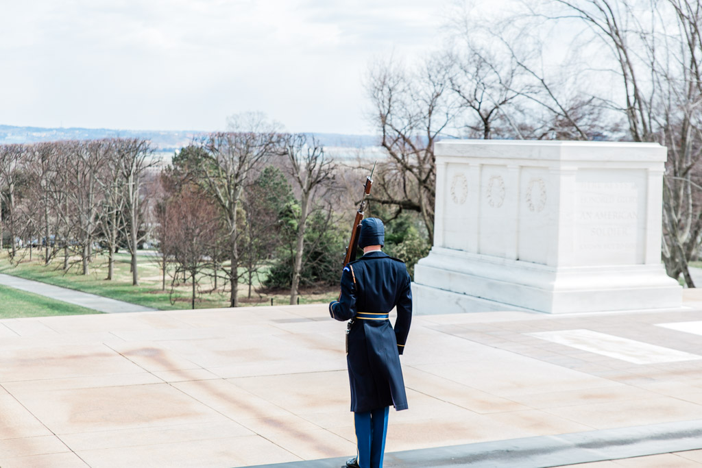 Member of the Old Guard standing watch at the Tomb of the Unknown Soldier at Arlington National Cemetery.