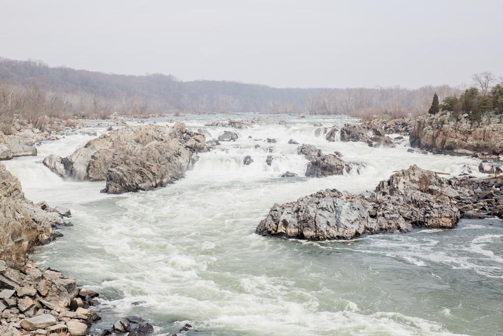 Rushing waterfalls over rocks at Great Falls National Park in McLean, Virginia.