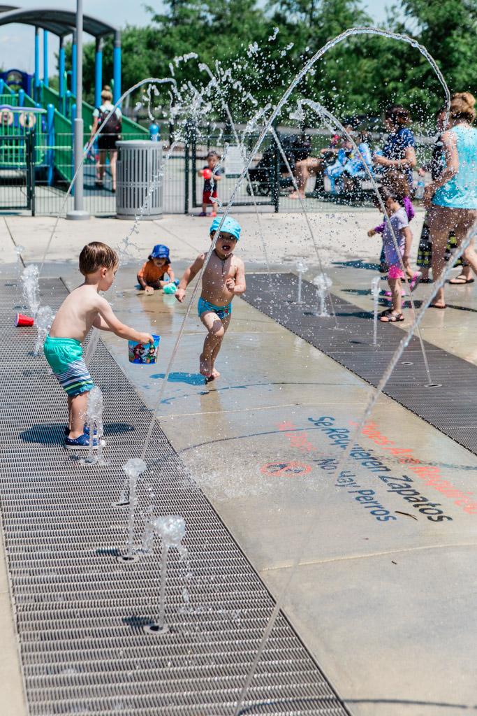 Kids playing and splashing at Potomac Yards Splash Park.