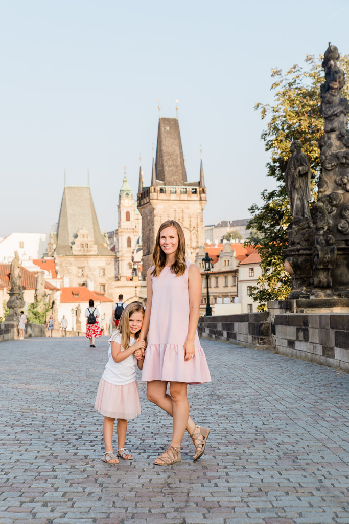 Mother daughter picture on an empty Charles Bridge in Prague.