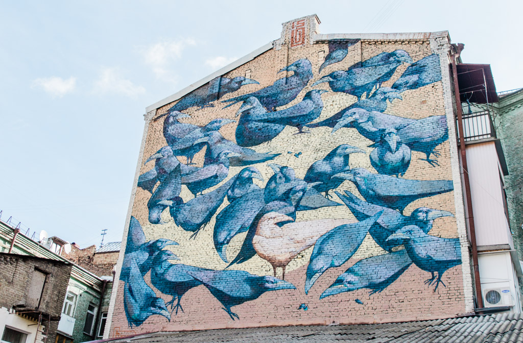 Mural of blue Ravens on a building in Kiev.