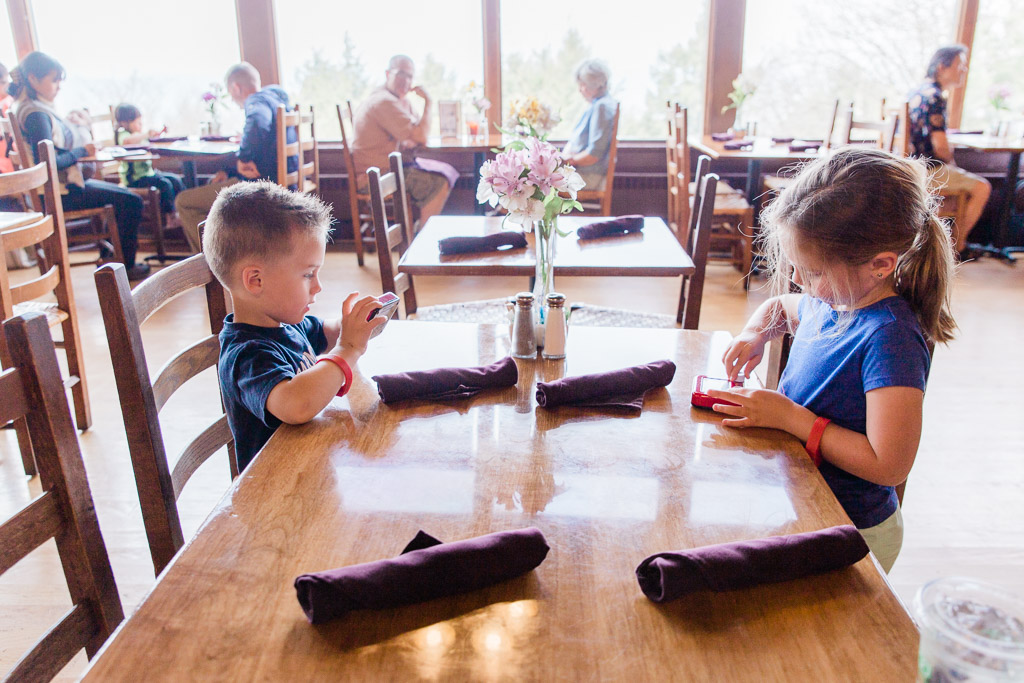 Little boy and girl playing with Etch-a-Sketch toys at table in Pollock Dining Room in Shenandoah National Park.