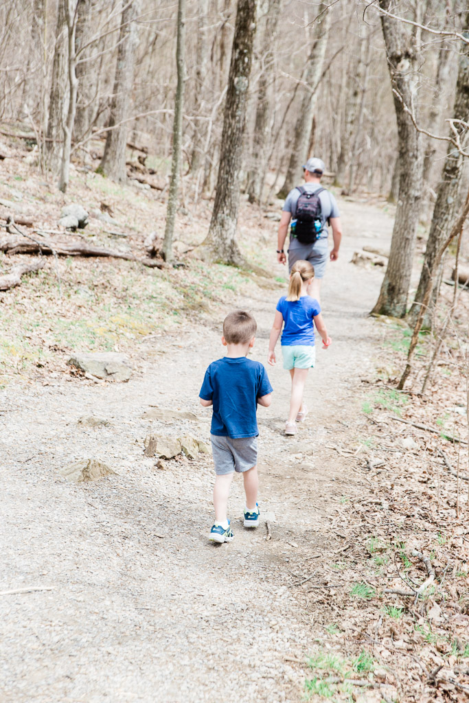 Little boy and girl following their dad on a hiking trail in Shenandoah National Park