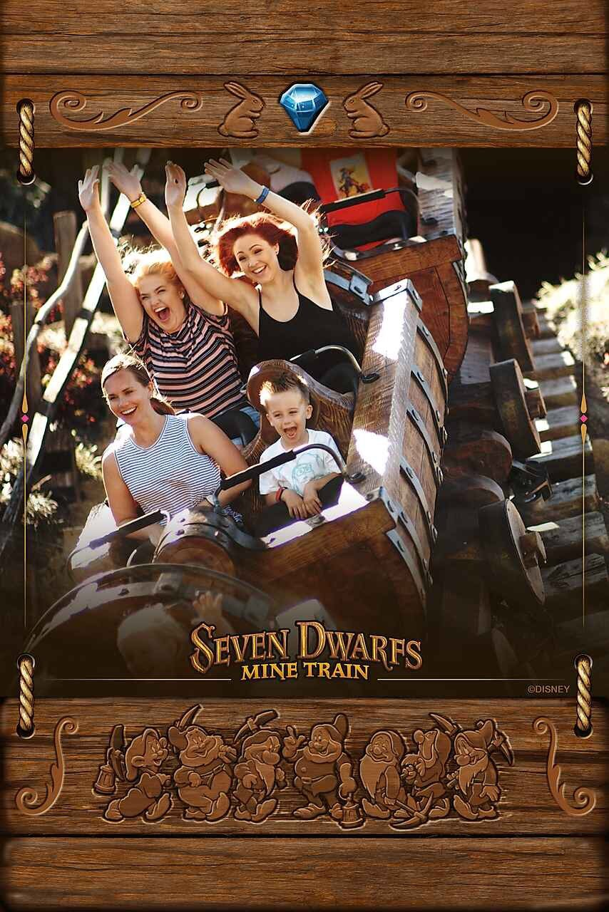 Photo of mother and young son on Seven Dwarfs Mine Train at Disney World.