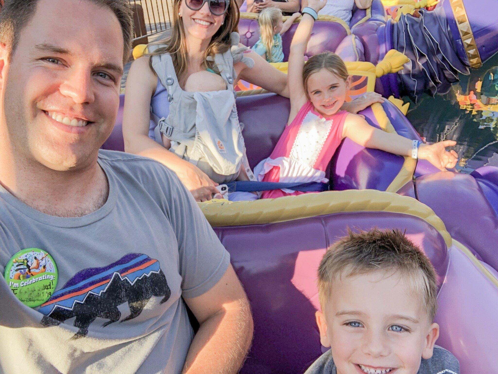 Family of 5 riding on Aladdin's Magic Carpets at Magic Kingdom Disney World.