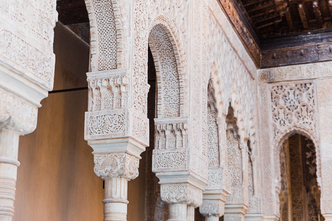 Details carved into the arches of the Nasrid Palaces at the Alhambra Palace in Granada, Spain.