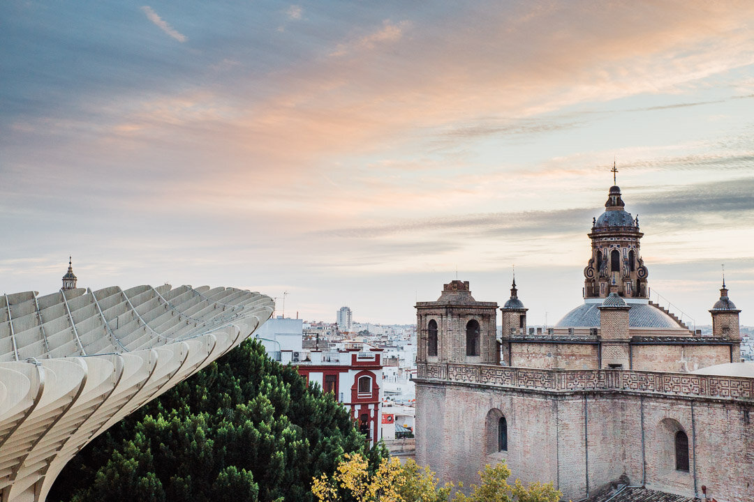 Sunset view from Las Setas de Seville with the Anunciation Church on the right.
