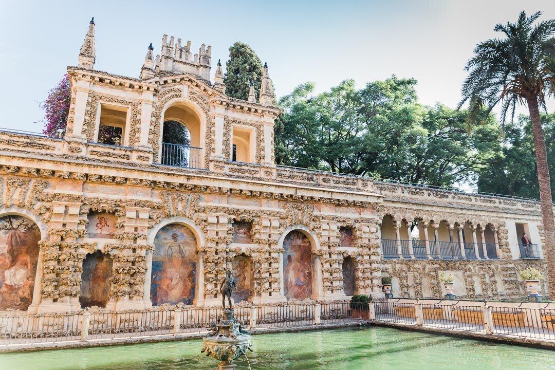 Fountain and outdoor porticos at the Reál Alcazar in Seville, Spain.