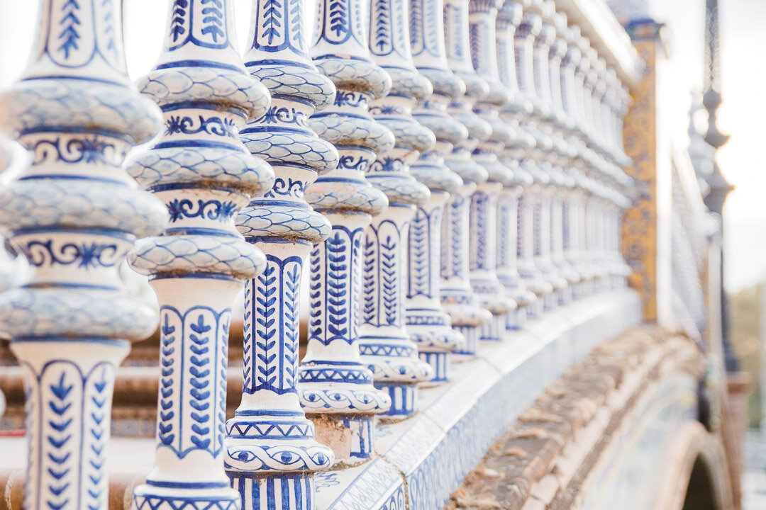 Blue painted details on the ceramic spindles of one of the bridges at Plaza de España in Seville, Spain.