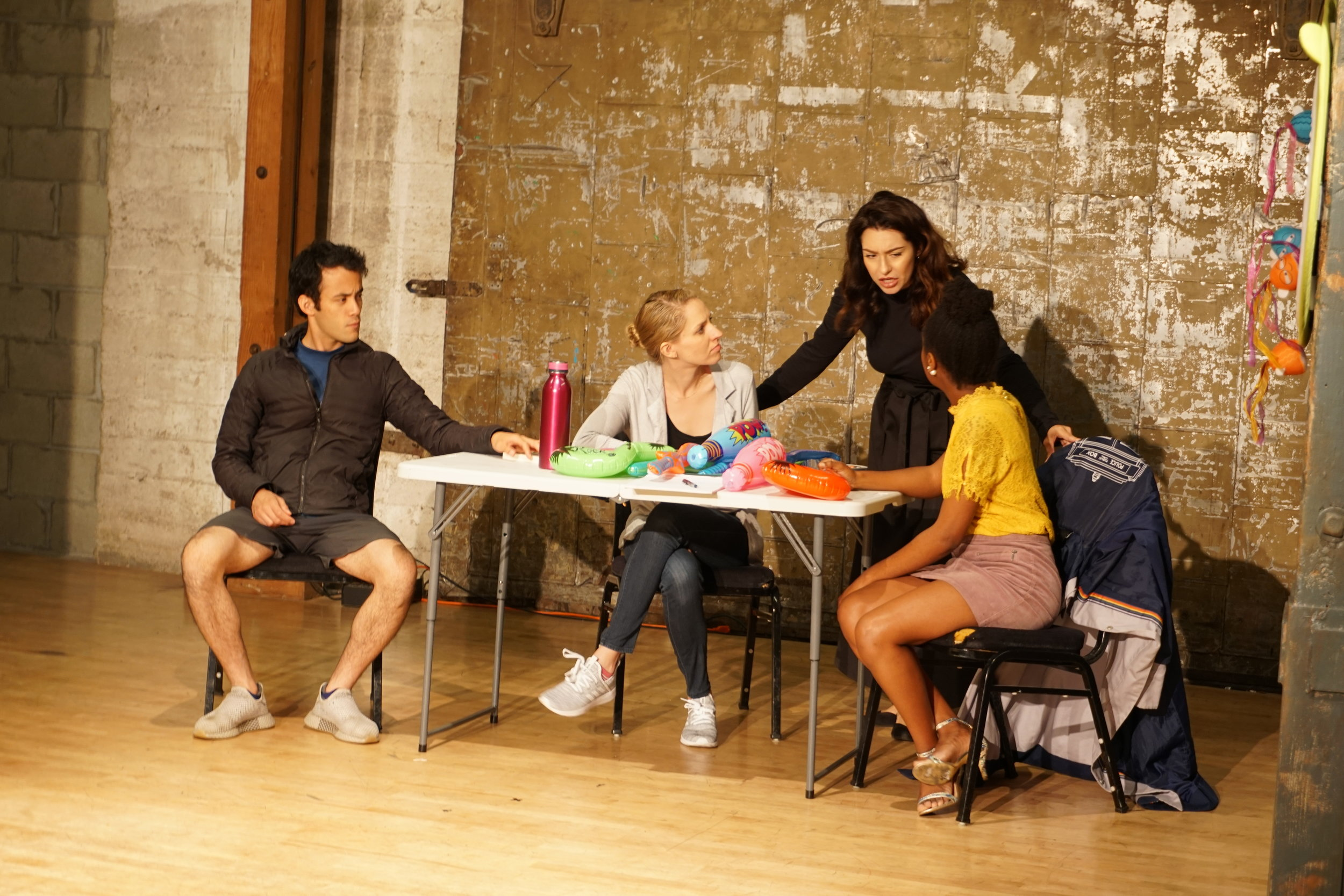 "Tony (David Castillo), Olivia (Emily Thebaut), Cybil (Maria Dominique Lopez), and Melody (Sherley-Ann Belleus) puzzle over the perfect game idea in ""The Girlfriend,"" the first collaboration between Amy Punt and me, produced with New Opera West. (May 2019)"