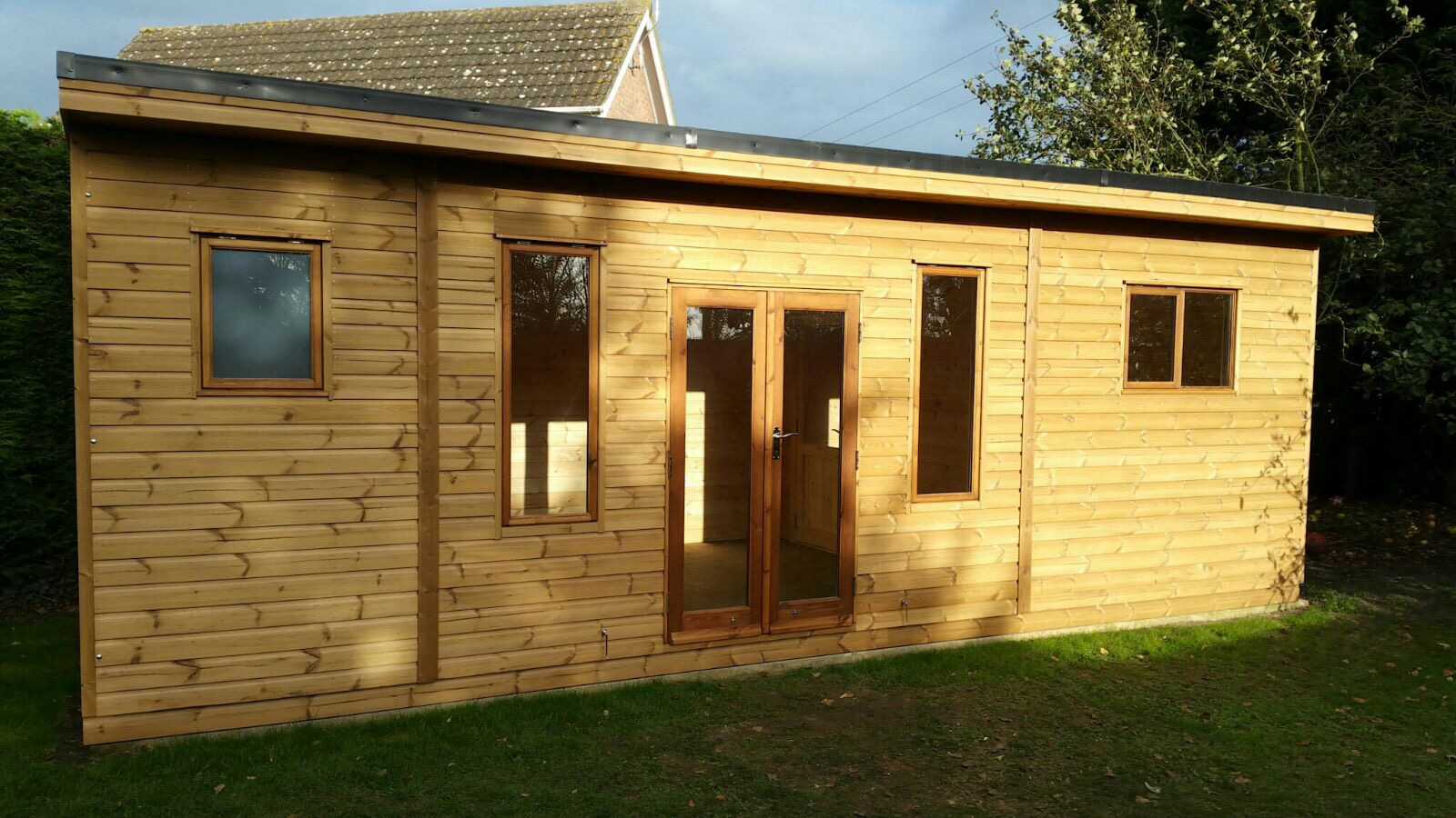 7.2M x 3M Thermowood Garden Room incorporating an ensuite bathroom, livving room and bedroom. Joinery windows and doors and EPDM roof with a 300mm overhang.JPG