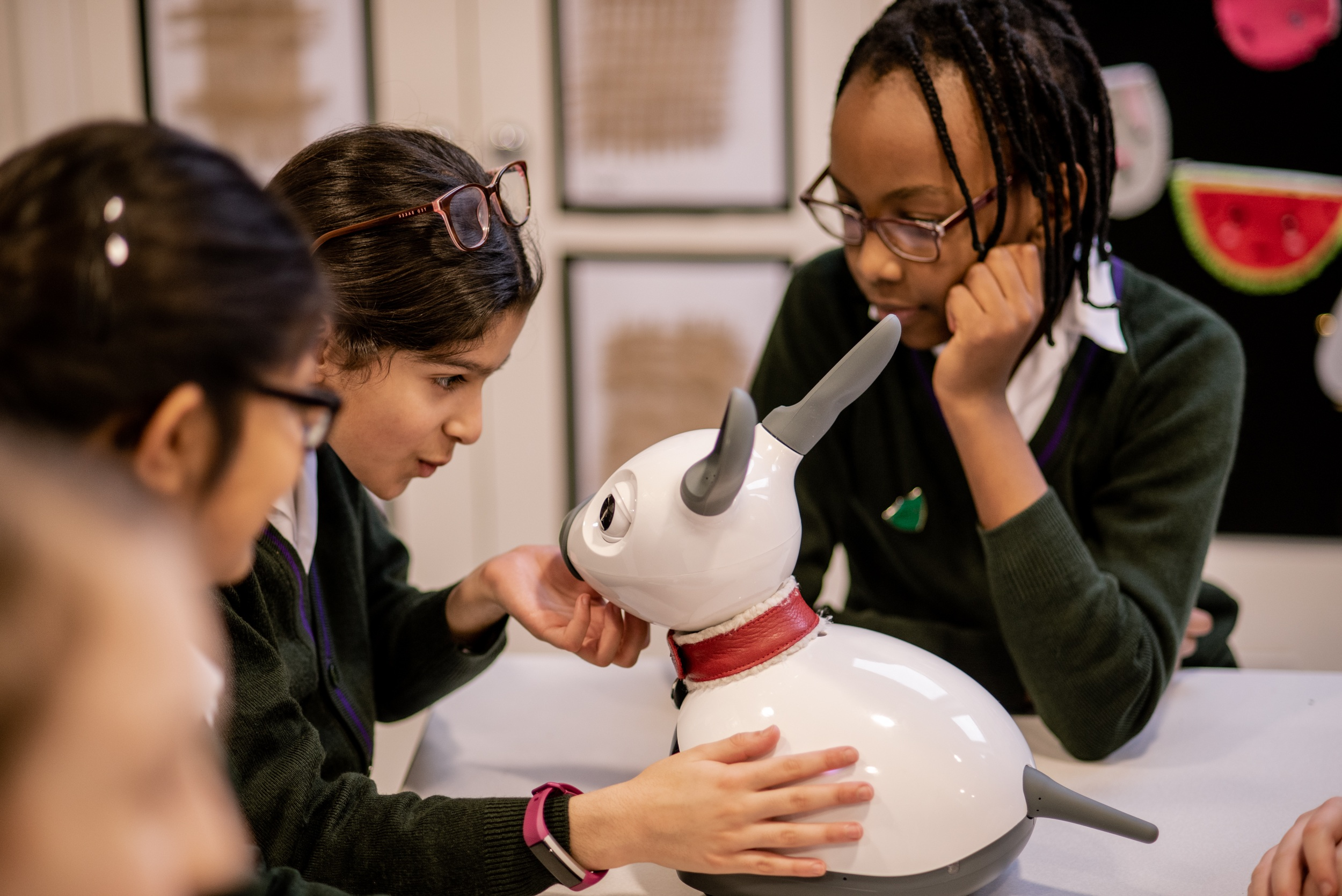 MiRo-E with students at a School in North London, UK.