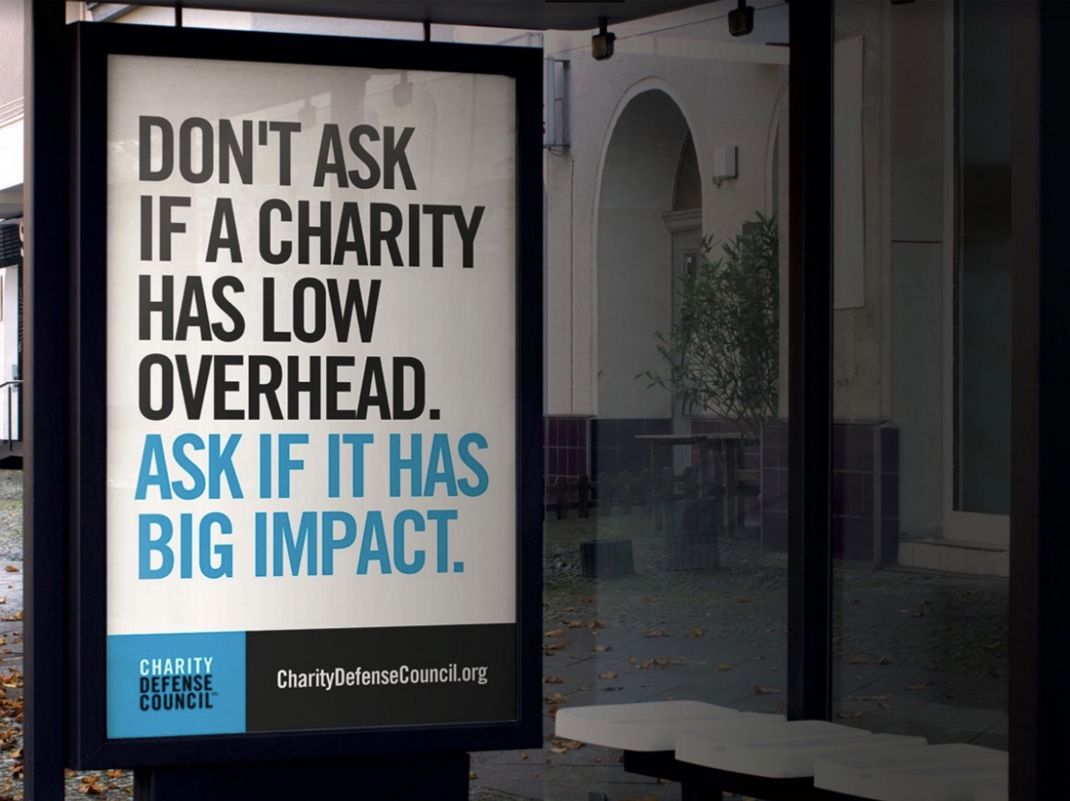 Overhead and impact are not the same. A bus stop ad taken out by the Charity Defense Council