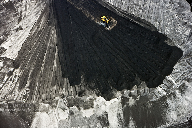 Sisyphus-  Bulldozer Pushing Petroleum Coke, Waste From Oil Refining