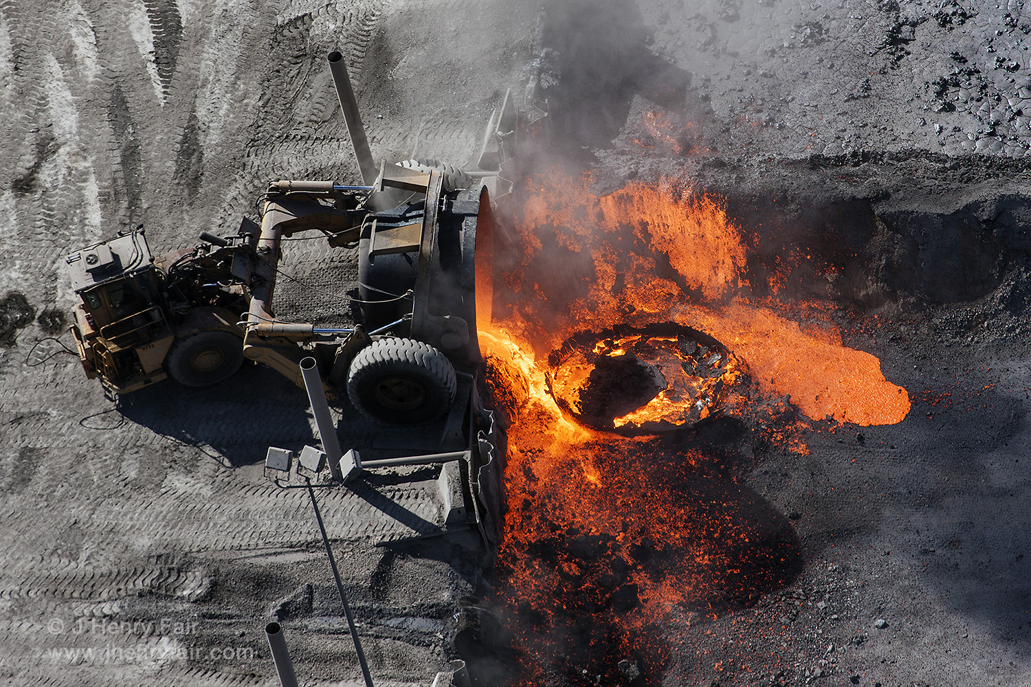 Truck Pours Waste Slag From Steel Mill Into A Pit