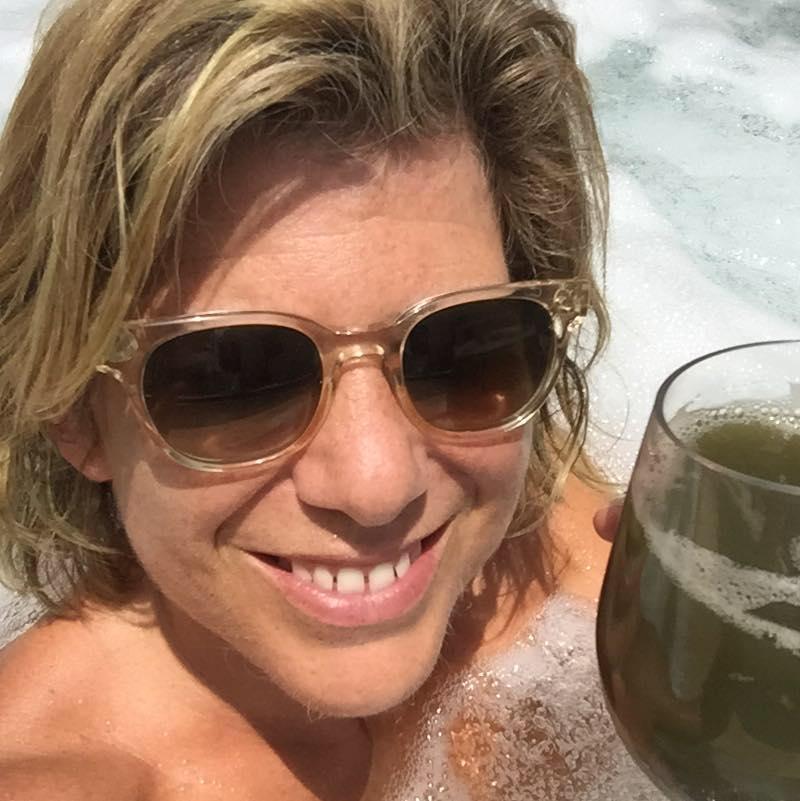 sascha in hot tub drinkg green juice.png