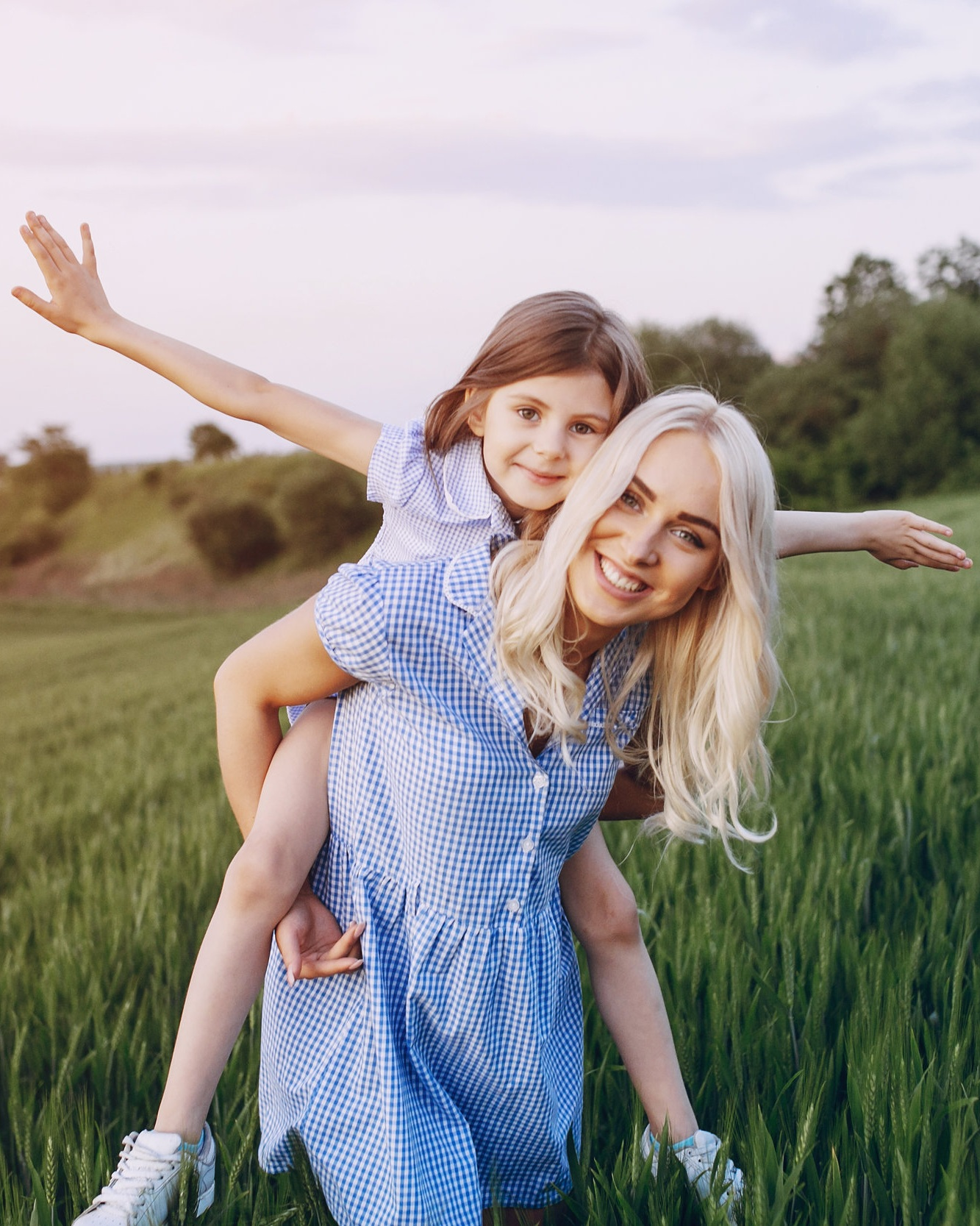 Mother and daughter playing outdoors.