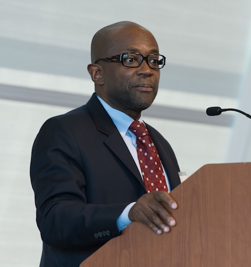 Yaw Nyarko, the director of NYU Center for Technology and Economic Development, shown giving a speech
