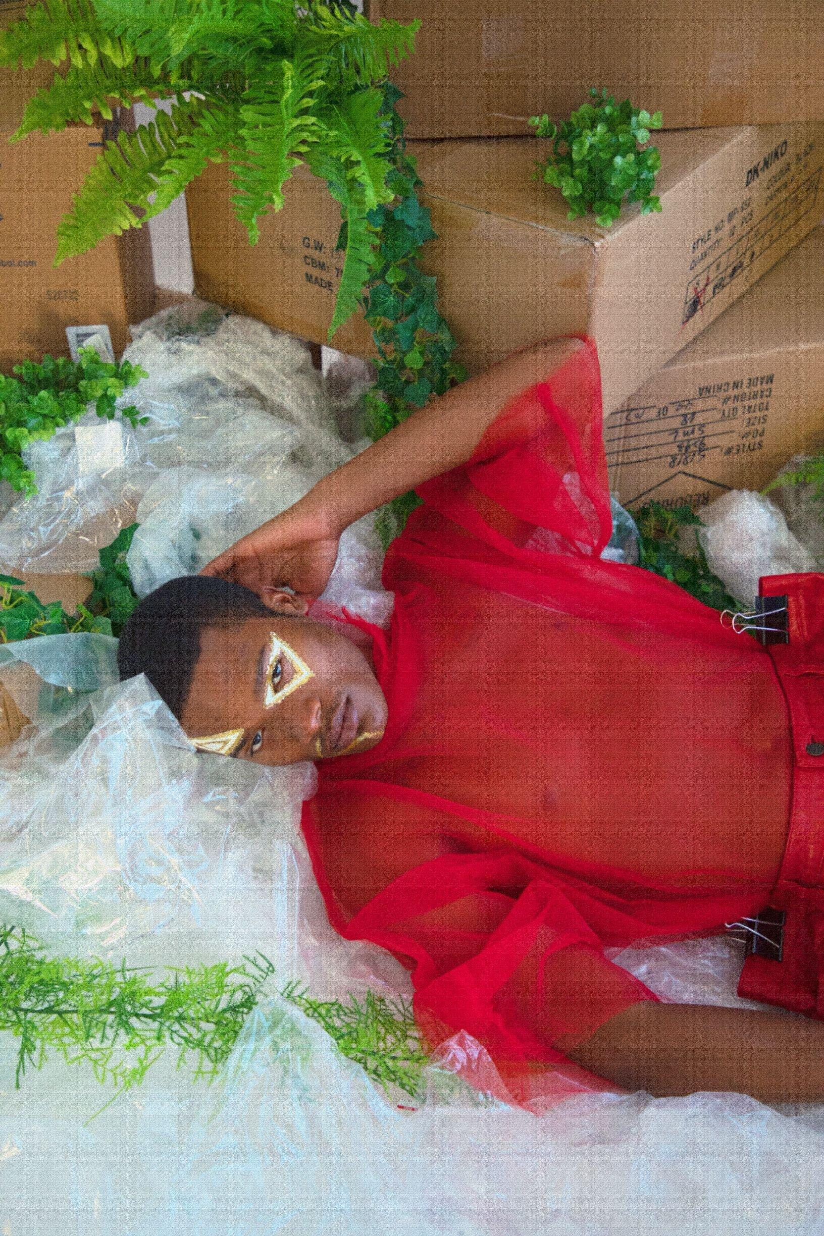 Model amid sea of plastic showcasing harm to the environment