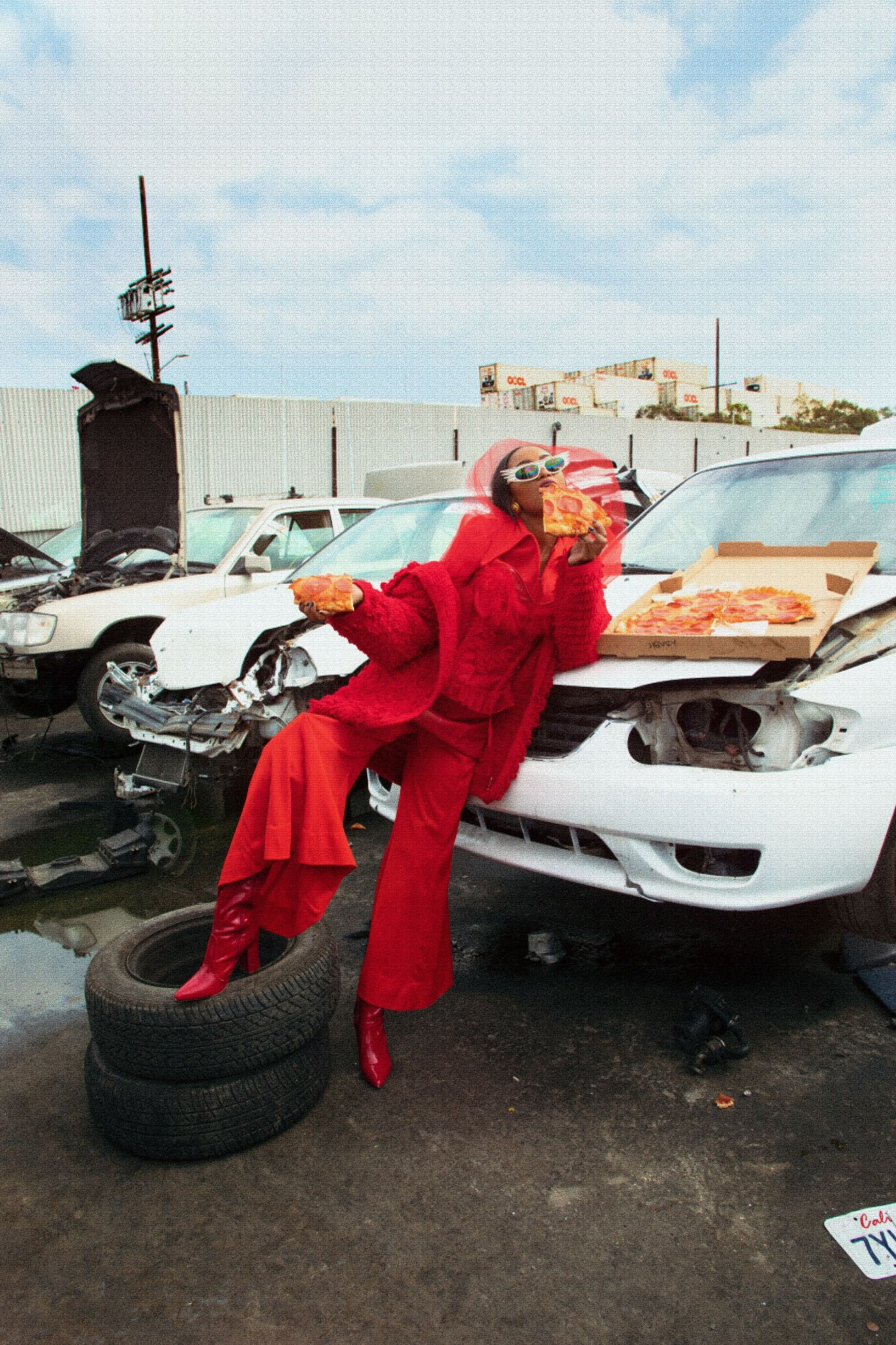 A model proves pizza and cars can be high fashion.