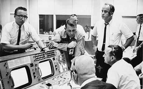 Photo Courtesy: NASA   NASA Mission Control Houston watching an Apollo Mission. Apollo astronauts Charlie Duke, Jim Lovell and Fred Haise watch Apollo 11 Land.