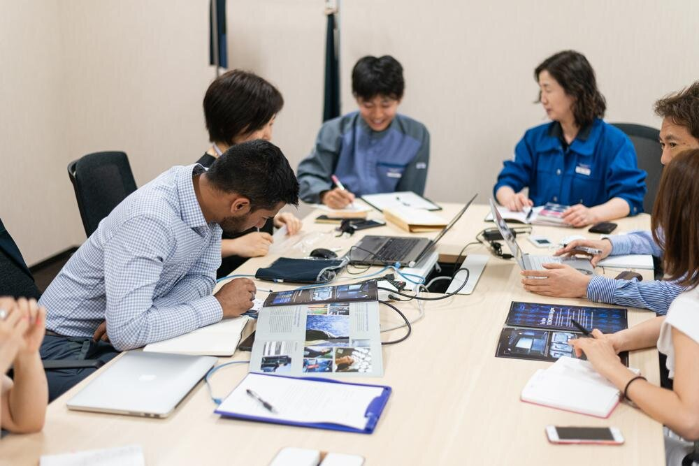 Design & Development meeting. Gihan and the Toray team review new innovations and test results.