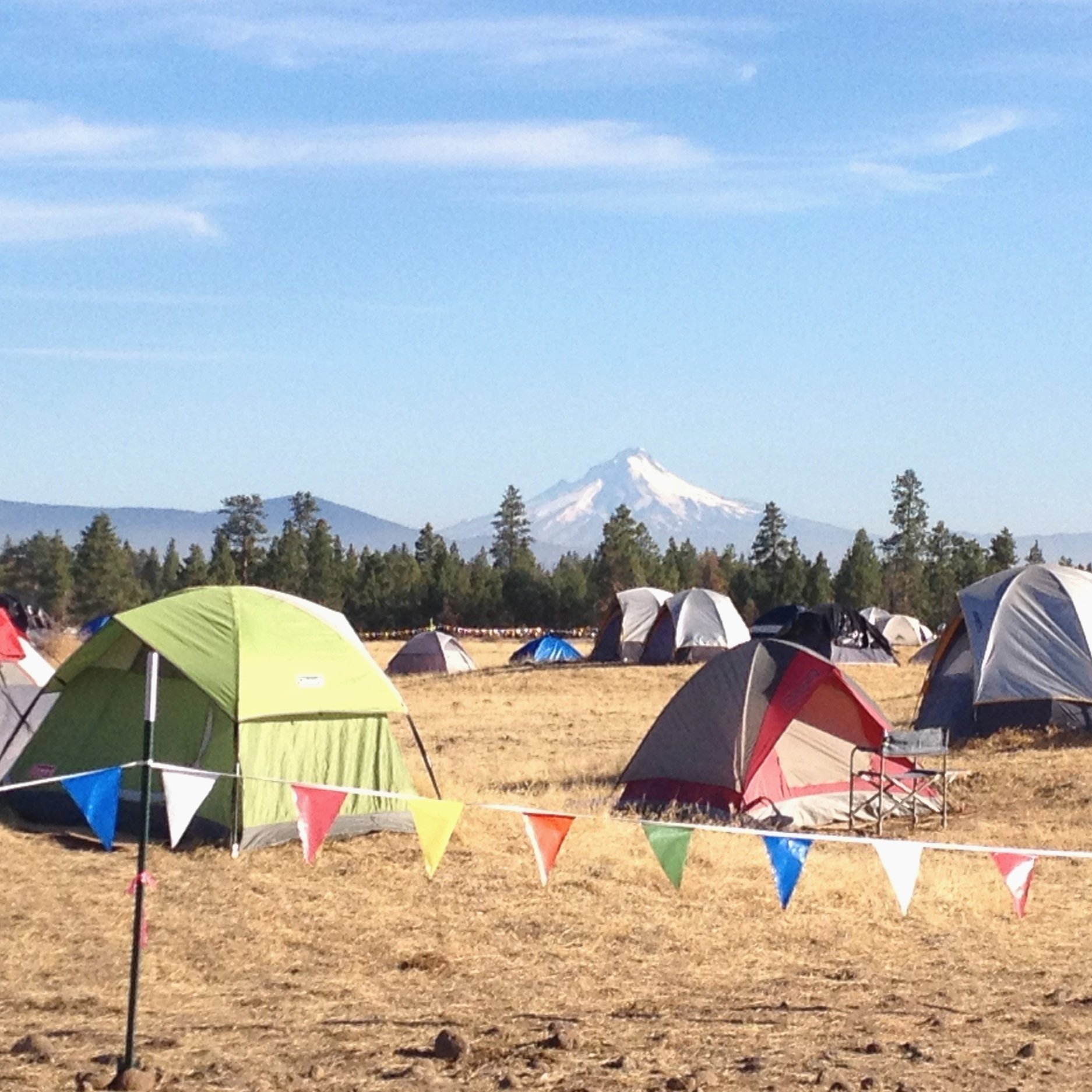 Main fire camp of a fire in Oregon in 2014. Fire positions that are camp based like logistics, medical, leadership, communications, or food tent, among others, generally keep their tents up the entire time they are on a roll. Wildland firefighters out on the fireline pack everything up before they start work because you never know what the fire will do and where you may need to go next.
