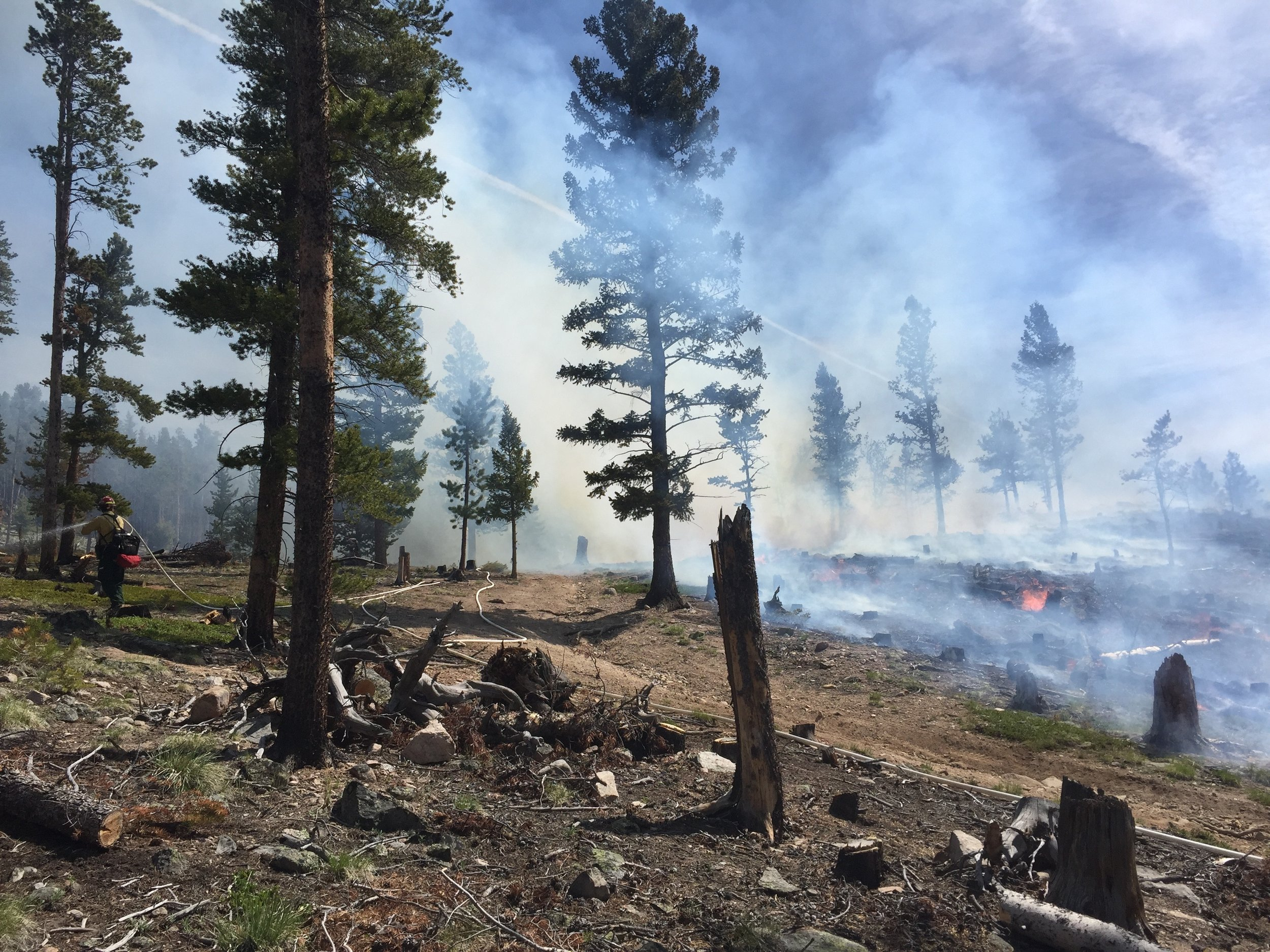 Watching for embers on a controlled burn in Colorado 2015.