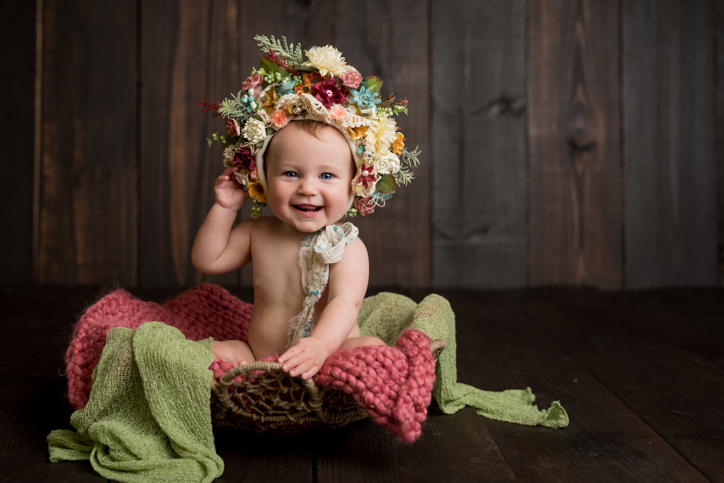 sitter session with junebug photography studio in manhattan, ks of a little girl in a flower bonnet