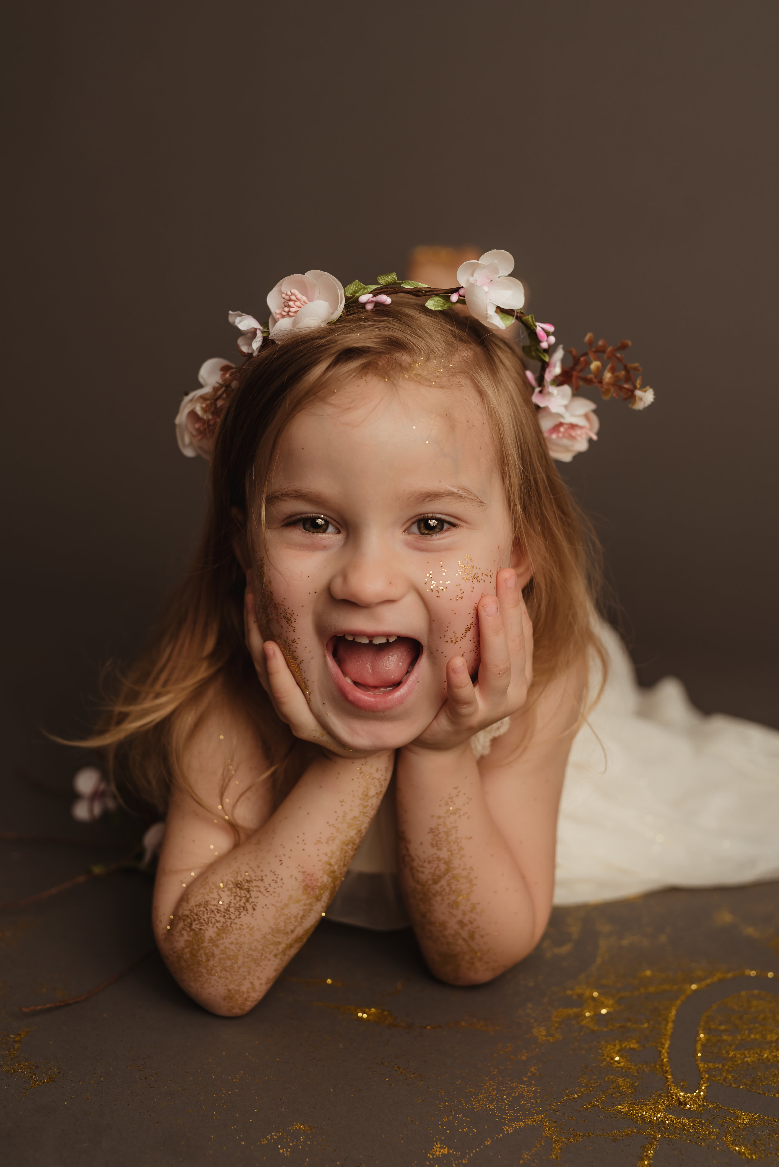 with junebug photography studio in manhattan, ks for a glitter session with a happy little girl