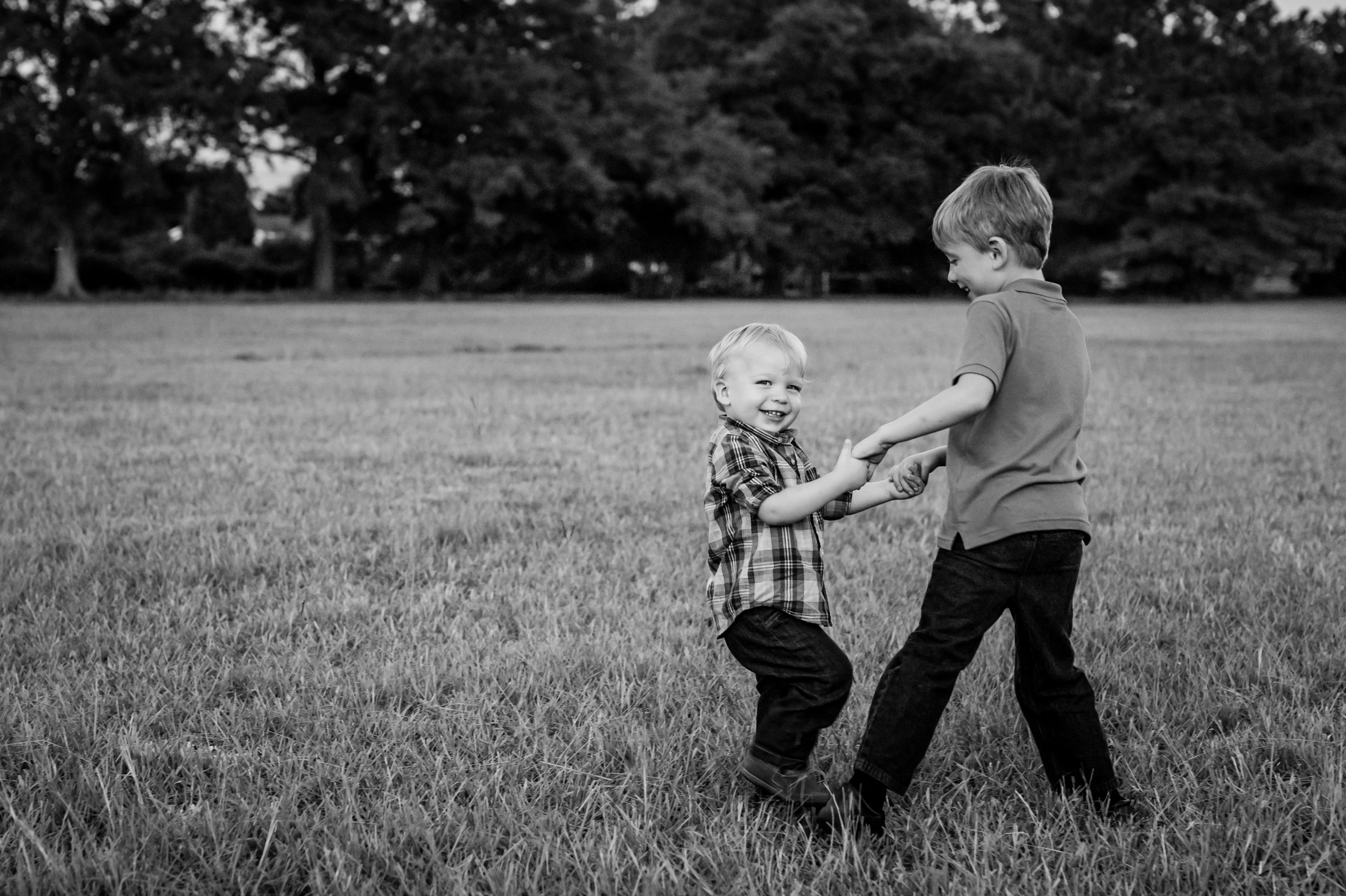 brothers playing ring around the rosey with junebug photography studio in manhattan, ks