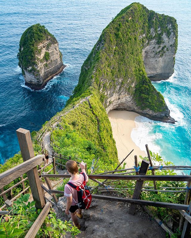 """Kelingkeling Beach is one of the most famous spots in Bali on social media and is definitely worth a visit. The hike down to the beach can be terrifying if you don't like heights. I don't like heights, but it wasn't a bad enough hike to stop me from going down to get better views. We visited here after having first visited Diamond Beach, and to me they looked pretty similar. The hike here is a lot more epic, though."" New post up on the @wayward journal about our time in Bali! Check our the link in our bio. #Explore_Enjoy"