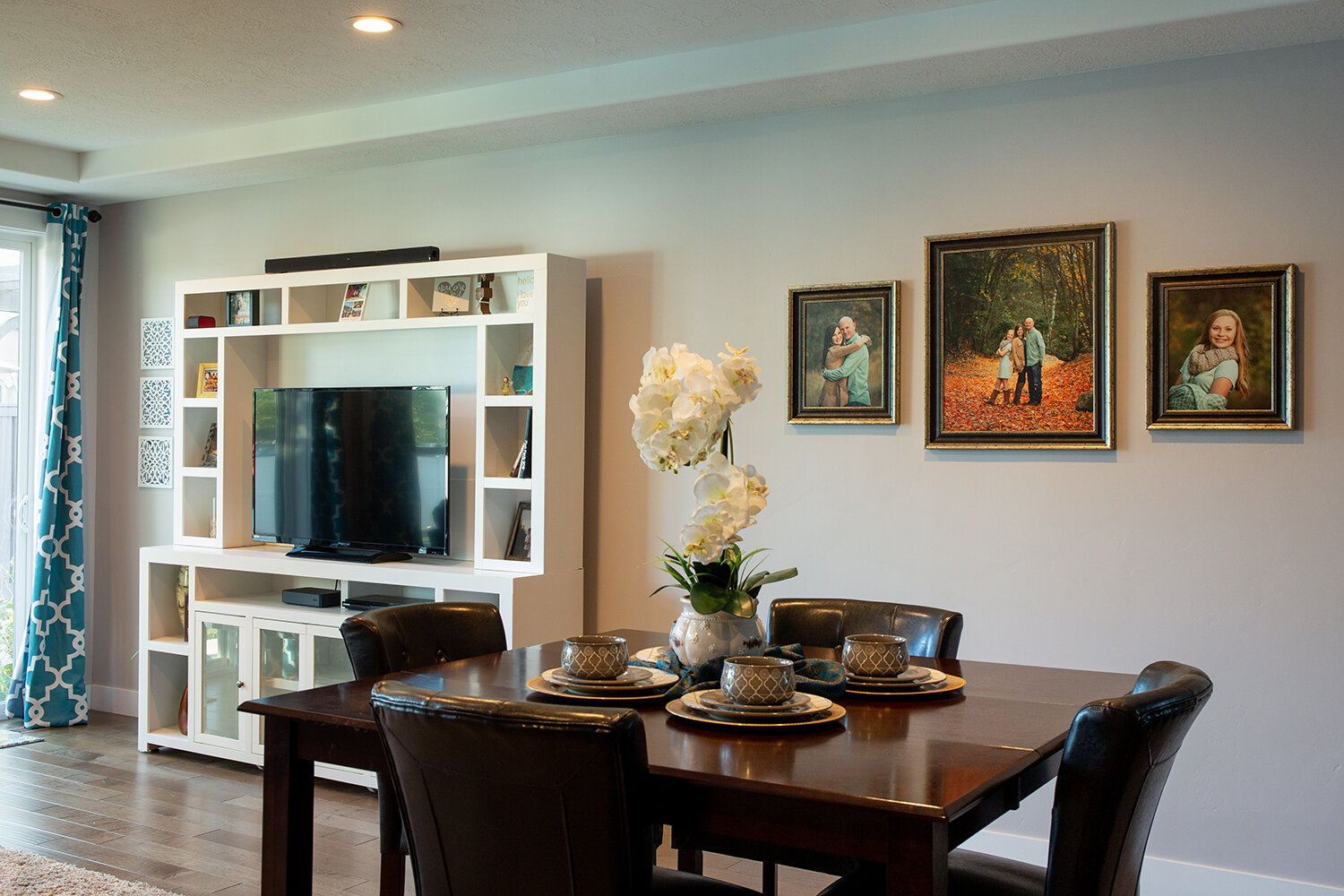 Display your portraits where you will see them most! The dining table is a great option.