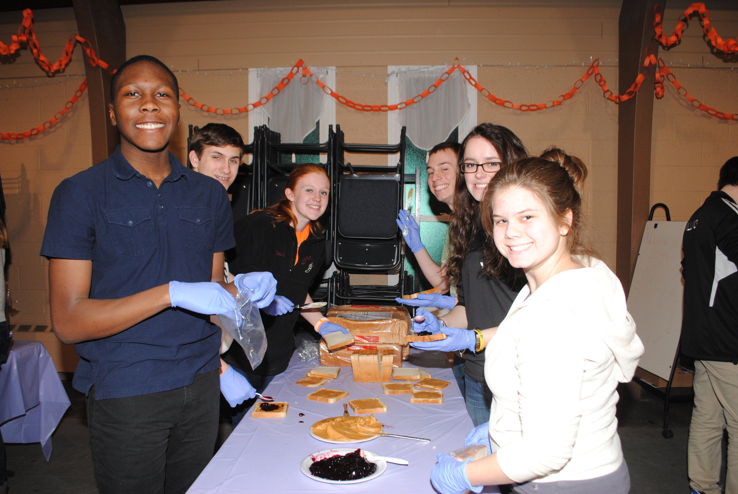 Peanut Butter & Jelly Gang: - These concerned volunteers meet every 3rd Friday of the month and make 800 Peanut Butter & Jelly sandwiches for the homeless. All volunteers, middle school and older, are welcome to join us. For more information, visit Steve O'Hagan at our Contact Page.