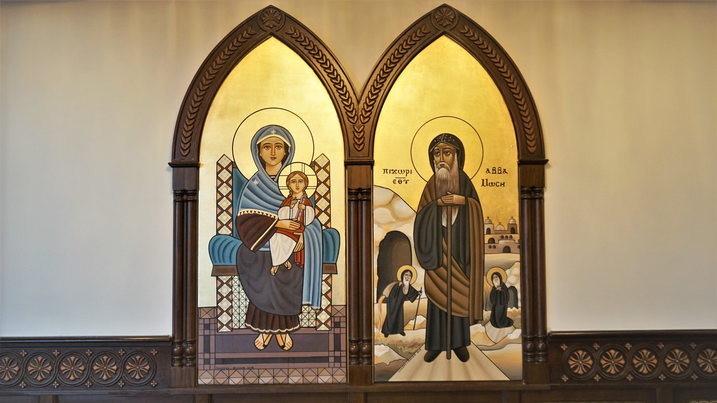 These, and similar iconography, can be found around the church. They depict St.Mary (left) and St.Moses (right) in traditional Coptic icon writing.