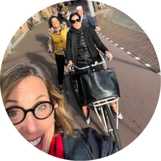 FWX Expeditioners riding bikes in Amsterdam