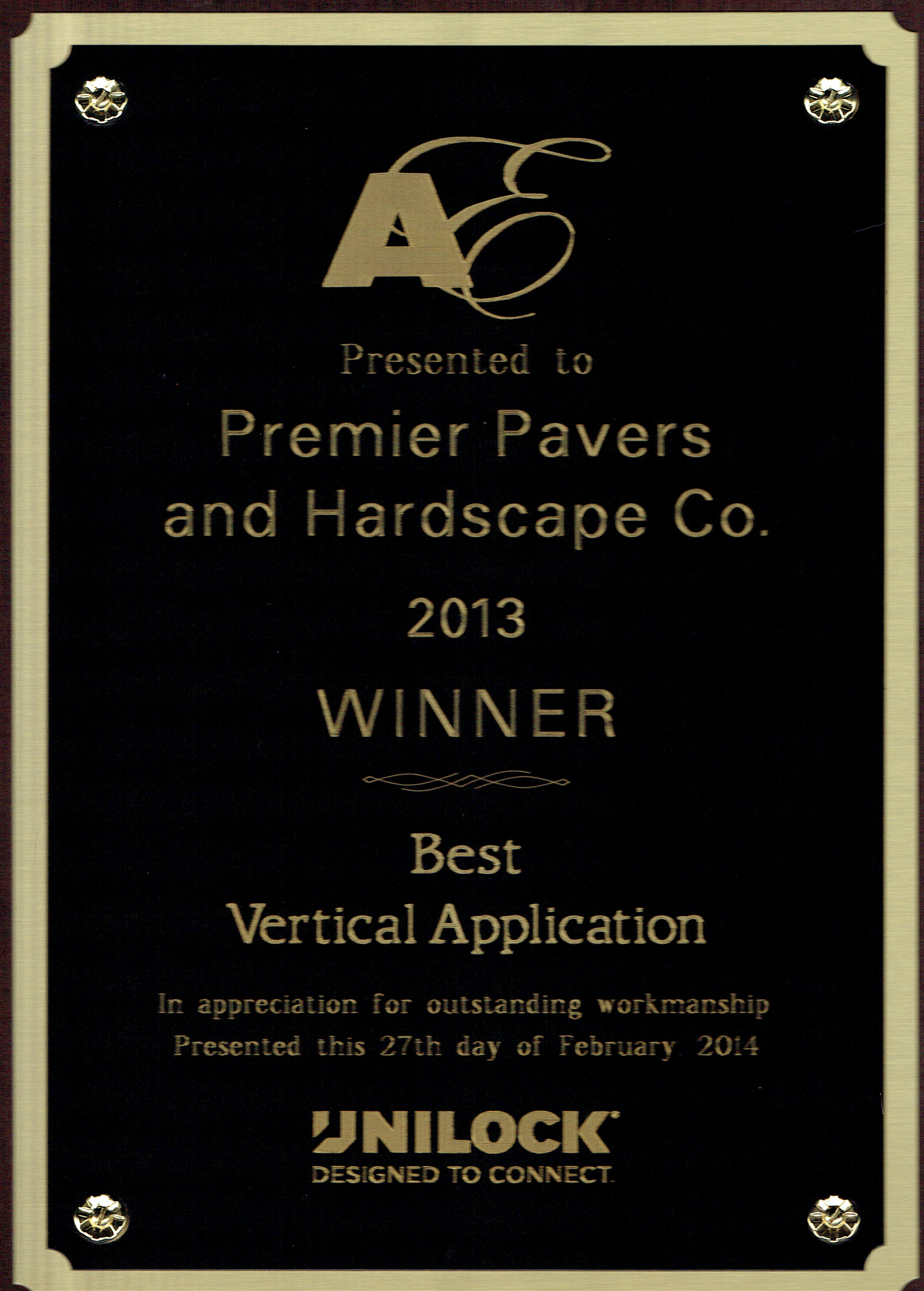 Brookline MA landscapers near me with Unilock award for best vertical application.