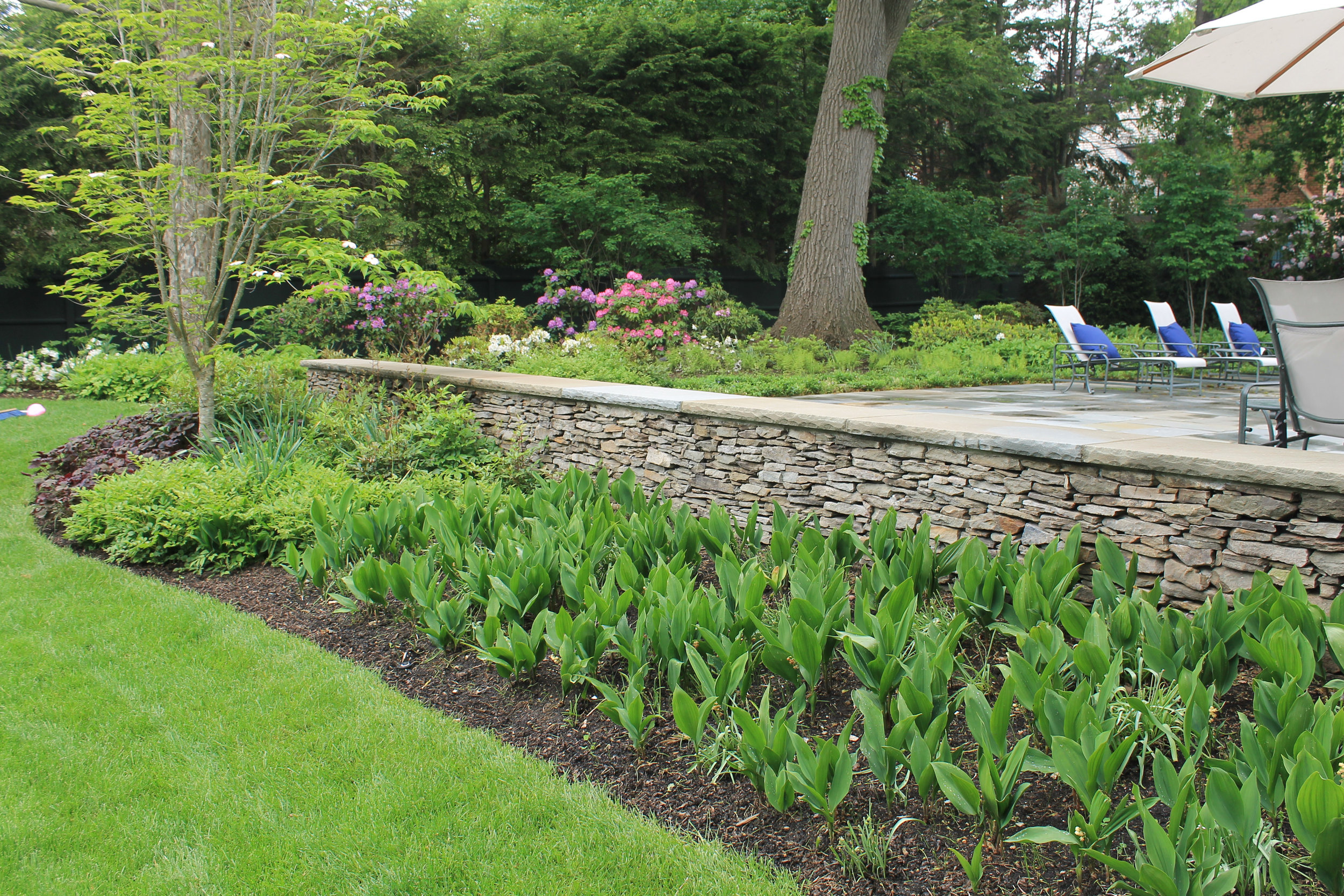 Landscape design with retaining wall in Wellesley, MA