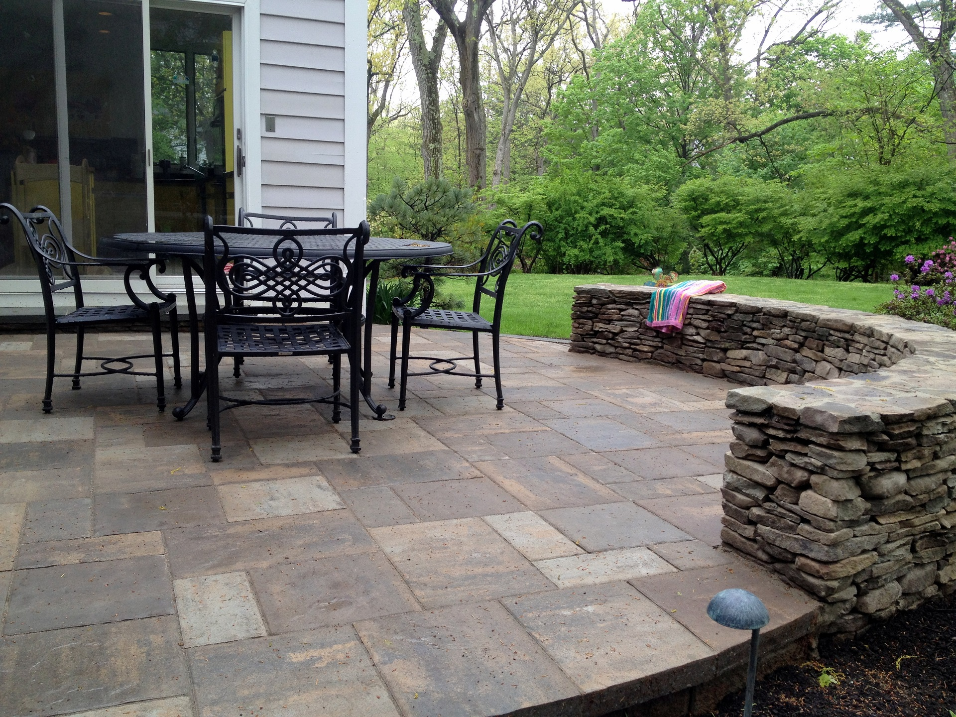 Beautiful bluestone patio with retaining wall in Newton, MA