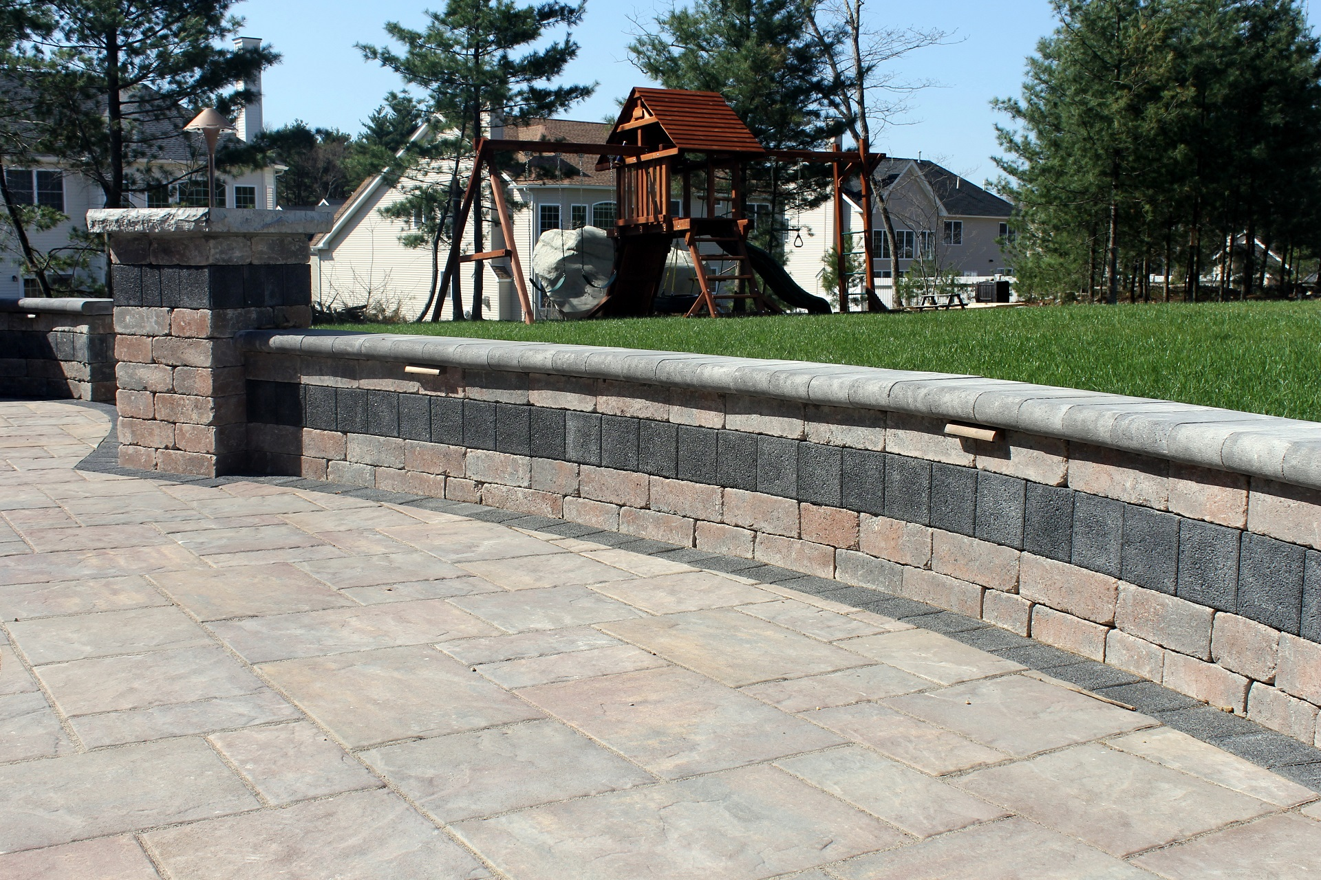Landscape design with durable retaining wall in Brookline, MA