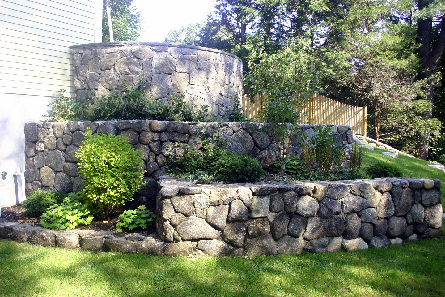 Top landscape design with retaining wall in Cambridge, MA