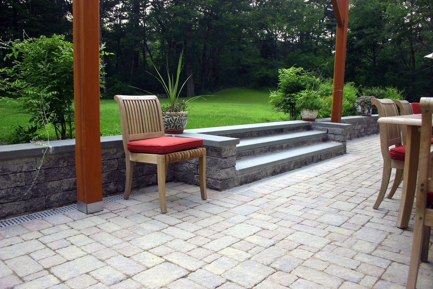 Bluestone patio with retaining wall in Lexington, MA