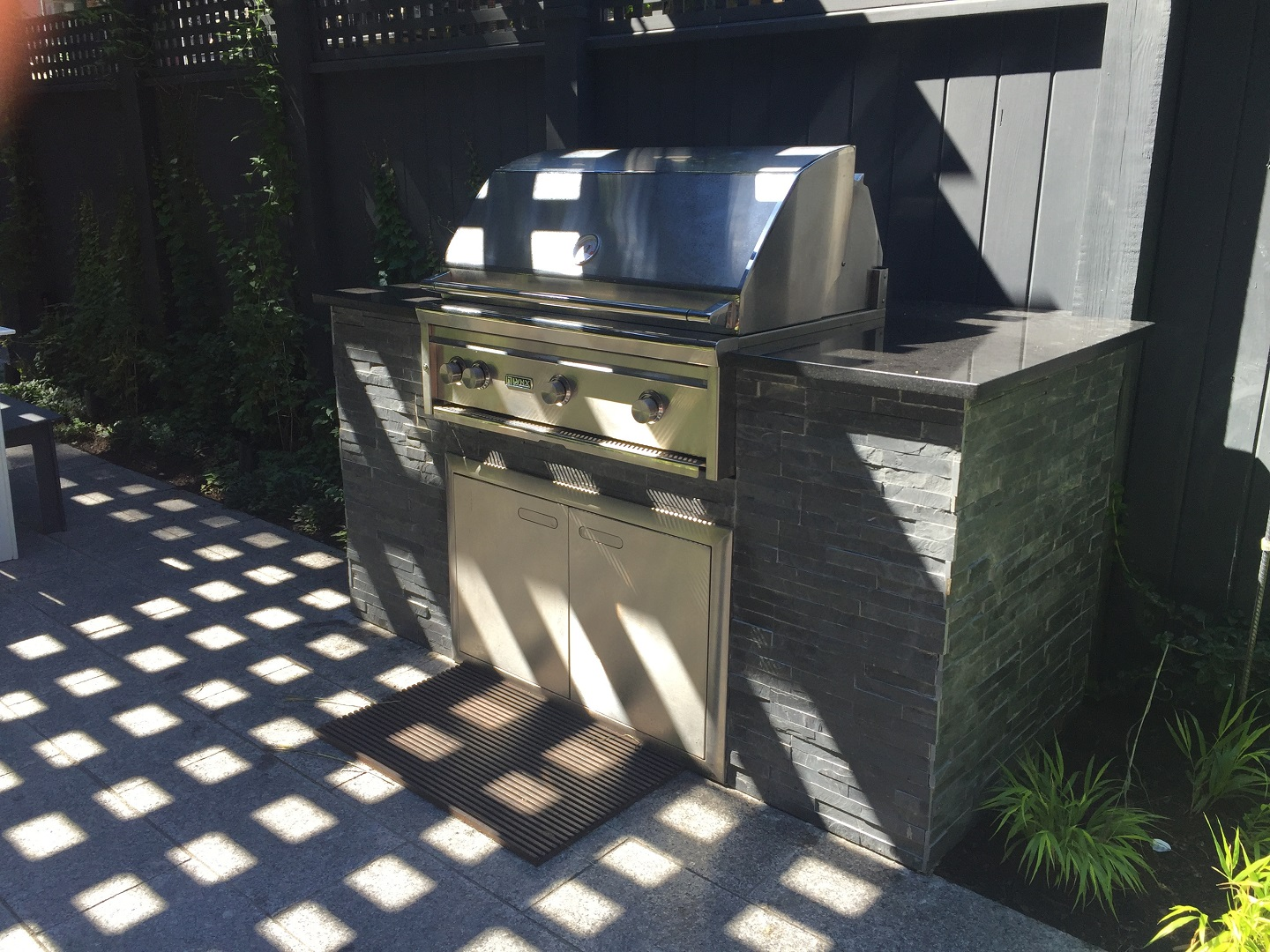 Landscape design with stunning outdoor kitchen in Lexington, MA