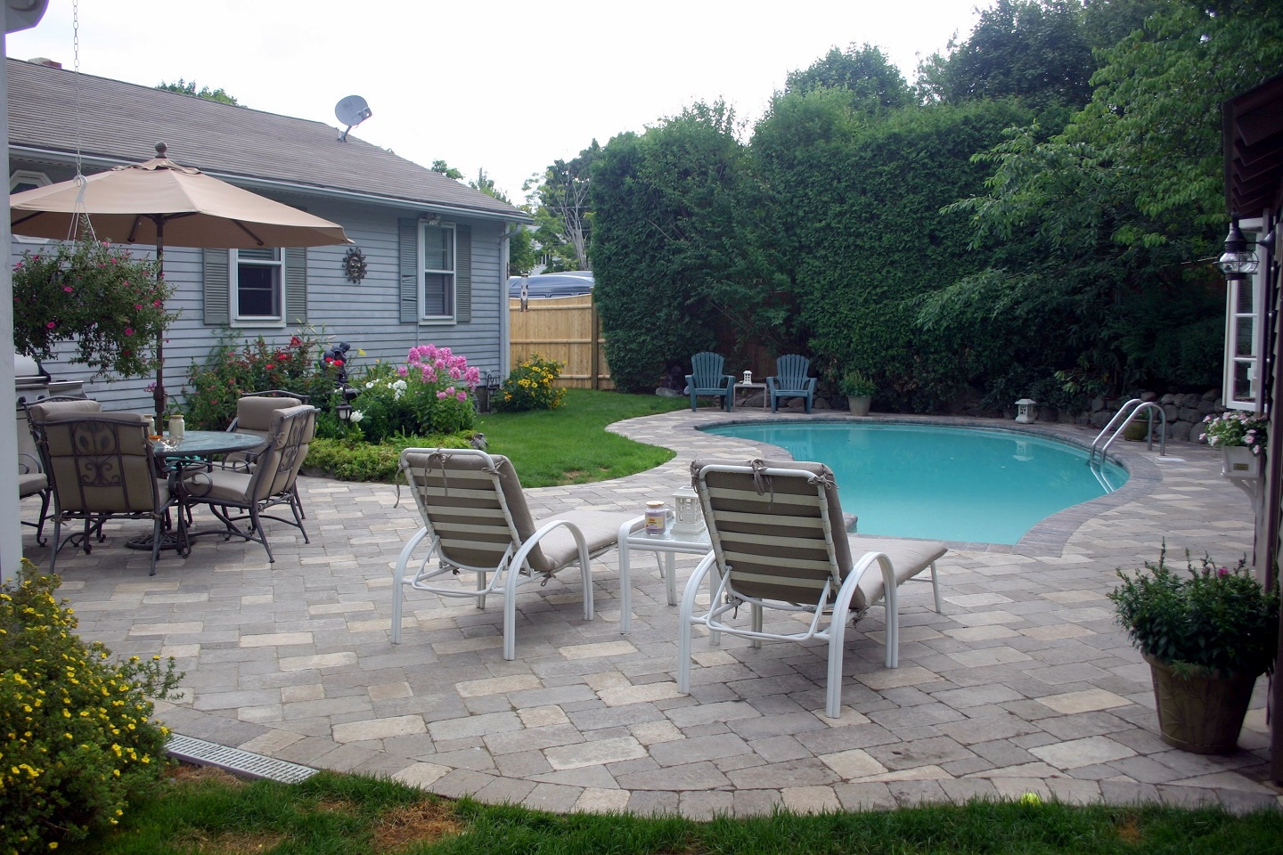 Pool deck with durable patio pavers in Newton, MA